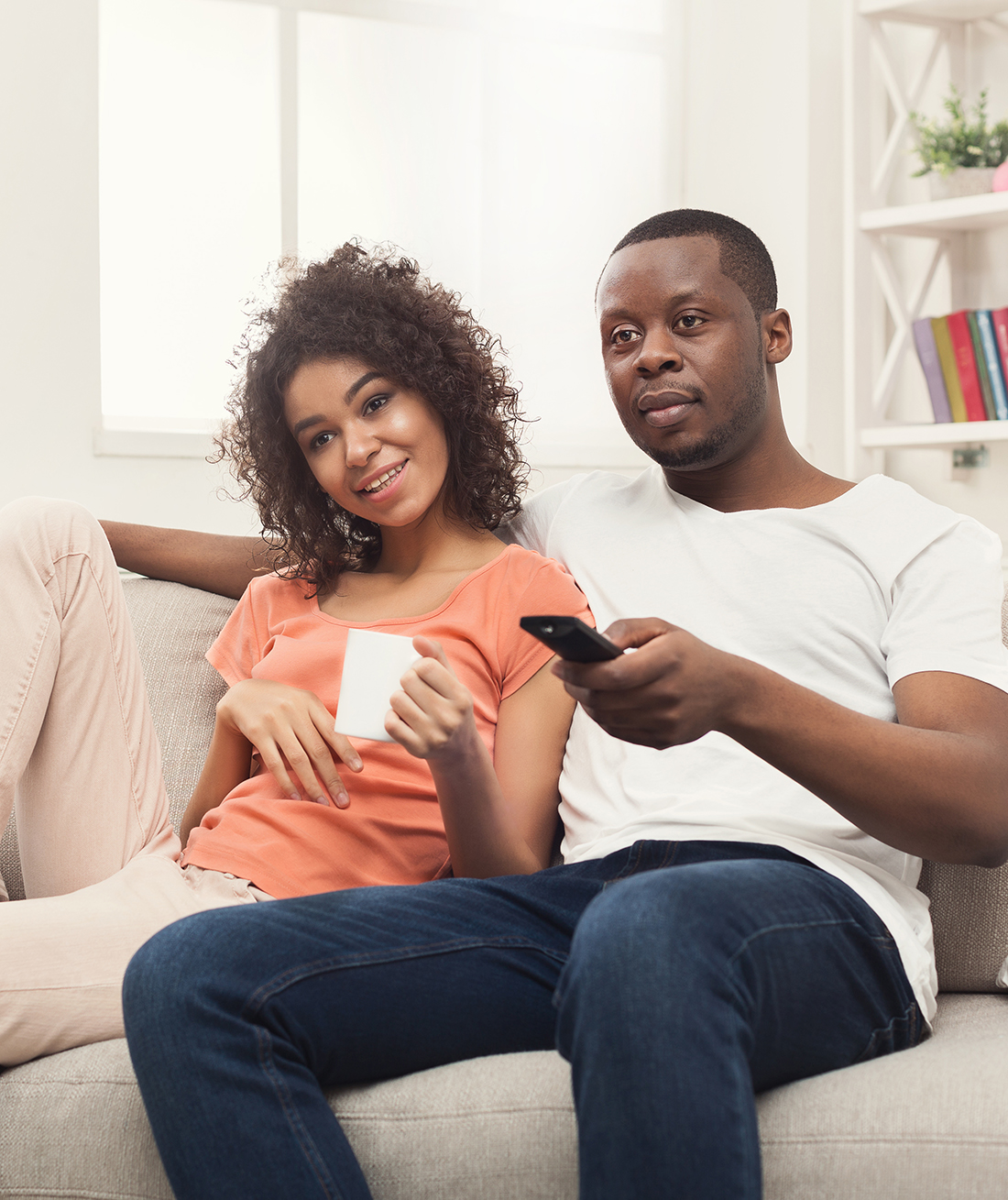 Image of a couple watching TV at home