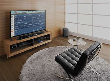 Image of a chair in front of a TV showing a scrolling TV listings channel