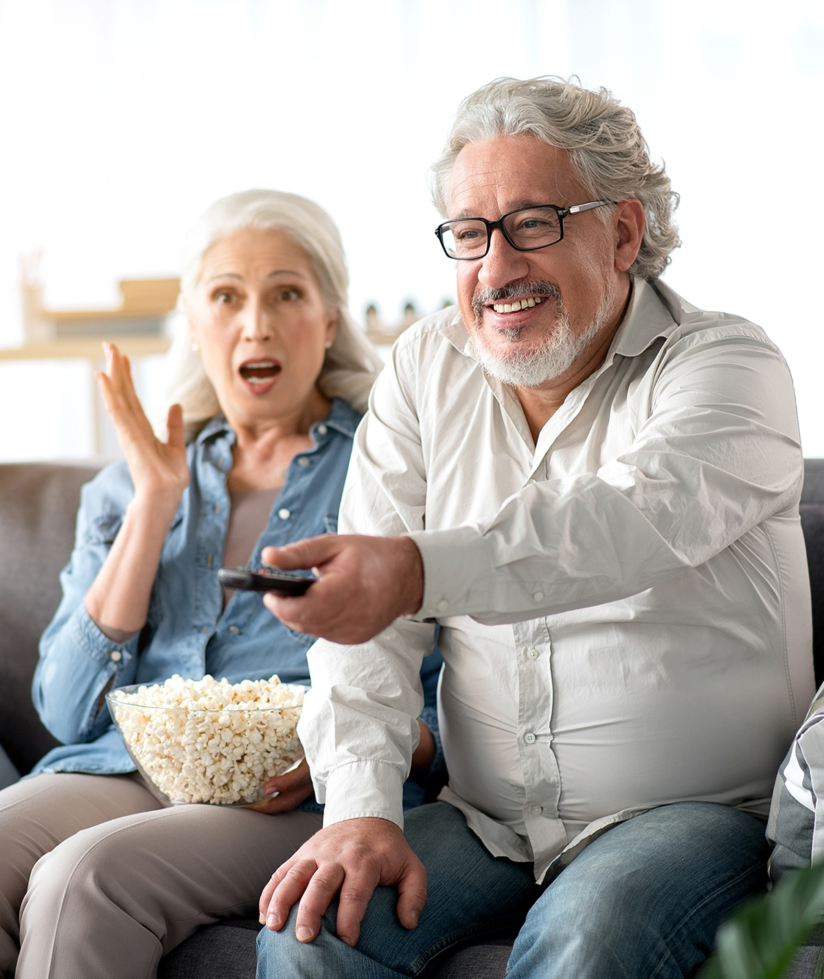 Image of mature married couple watching TV together