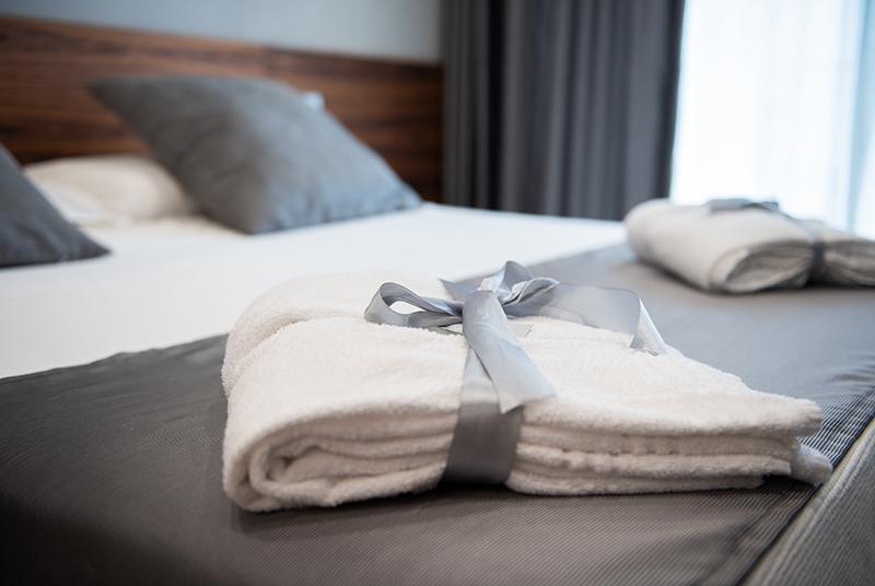 Bathrobe on bed in hotel room